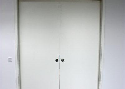 2 flügelige Schiebetür - in der Wand laufend mit Türfutter in Weißlack Nr1